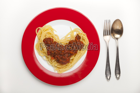 heart shaped spaghetti on a plate