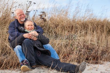 senior happy couple making a beach