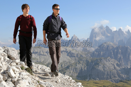 young men walking in the mountains