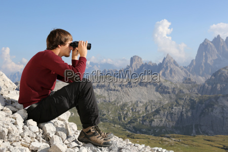 with binoculars valley view in the
