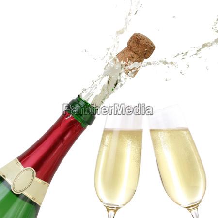 champagne splashing out of bottle