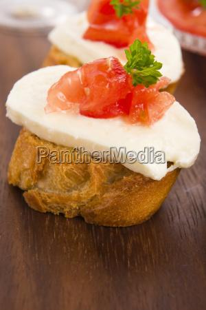 bruschetta with mozarella and tomatoes