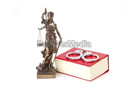 justizia with law book and handcuffs