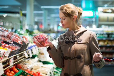 pretty young woman shopping for fruits