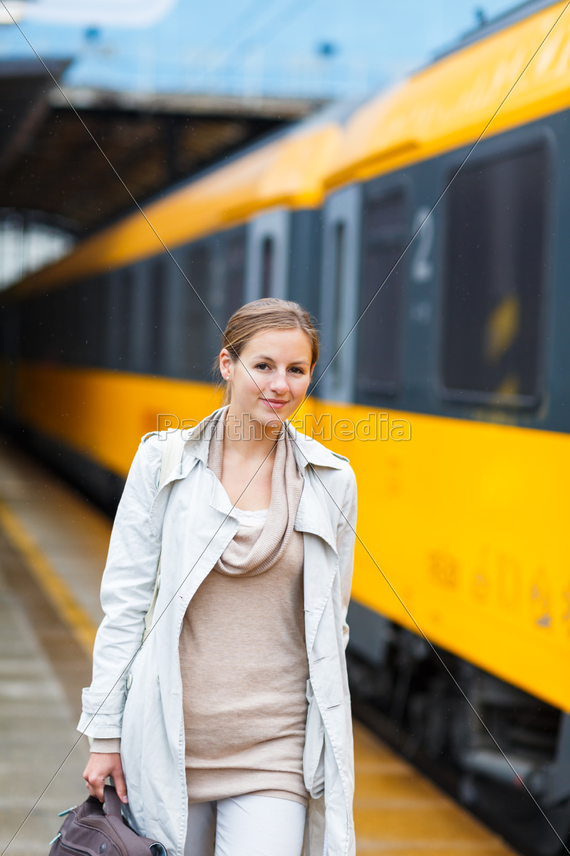 pretty, young, woman, at, a, train - 10325329