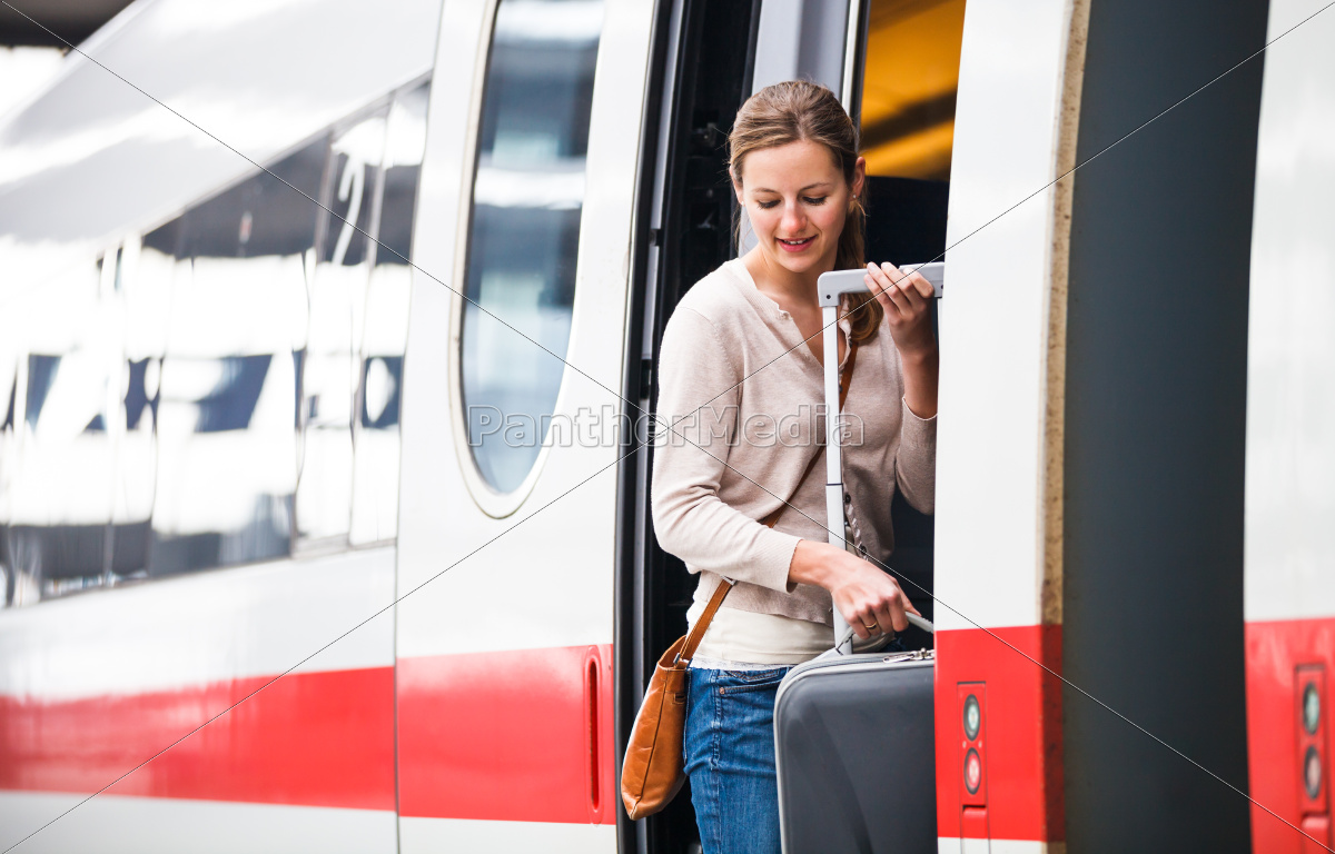 pretty, young, woman, boarding, a, train - 10325315