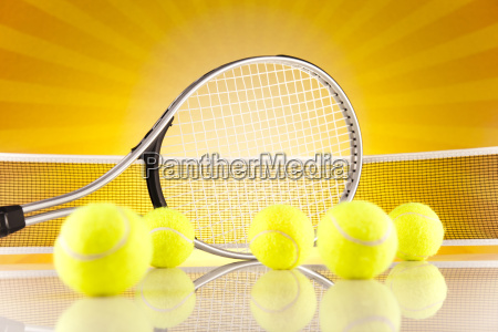 tennis racket and balls