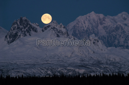 full moonrise over mount mckinley denali