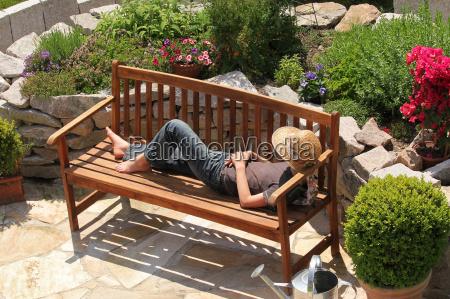 relaxing on a garden bench