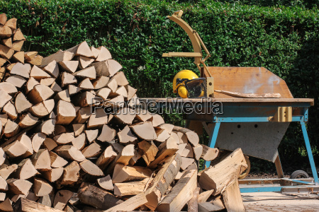 circular saw with wood logs and