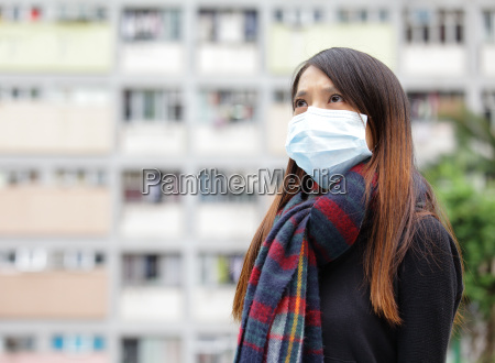 asian woman with face mask at