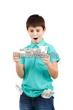 amazed boy looks at the bill