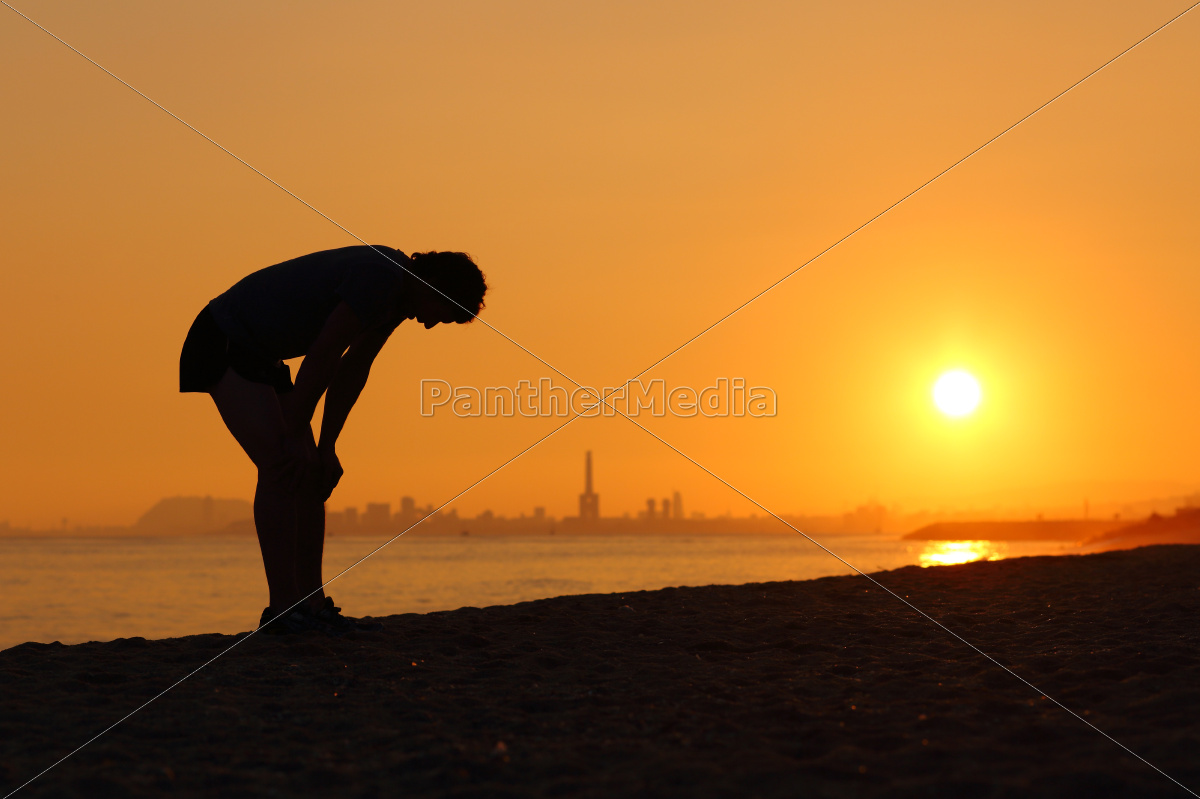 silhouette, of, an, tired, sportsman, at - 10478365