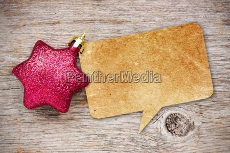 paper speech bubble with christmas bauble