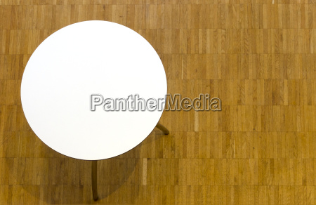 round white table on parquet floor
