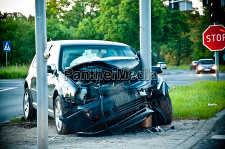 wrecked car after hitting a lamp