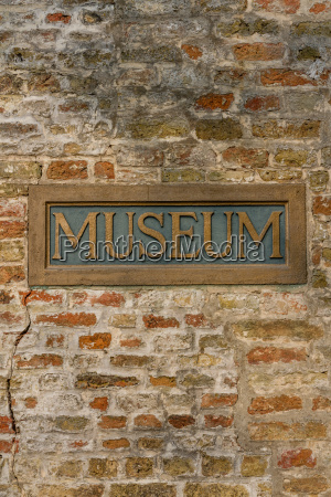 vintage metal museum sign inlaid in