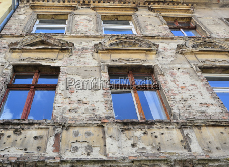old facade with war damage in