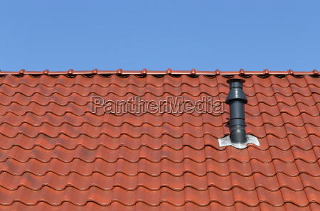 red roof with chimney against a