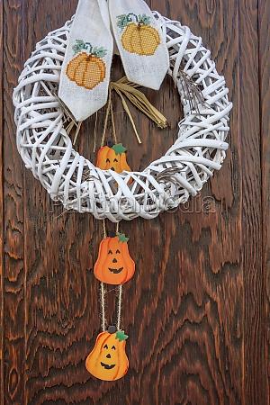 halloween pumpkin decoration on wooden door