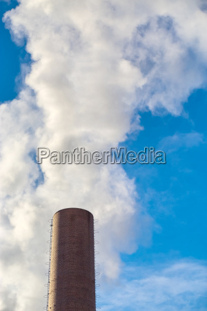 chimney with smoke in front of