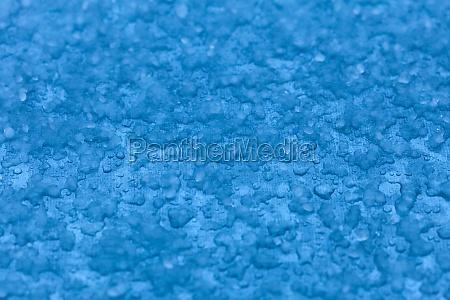 macro melt snow blue background texture