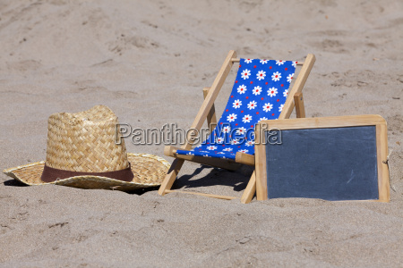 beach chair straw hat and a