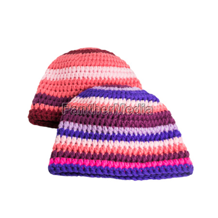 two crocheted hats with stripes