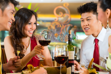 chinese couples toasting with wine in