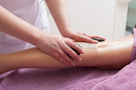 spa salon female legs having a