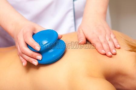 spa salon woman relaxing having cupping