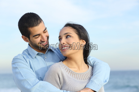 arab casual couple cuddling happy with