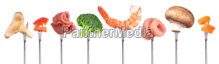 ingredients on skewers fondue