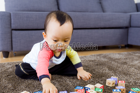 baby play with toy block