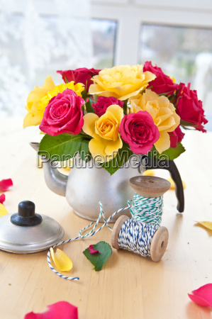 colorful roses in small jug