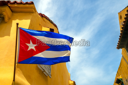 cuban flag and colonial buildings