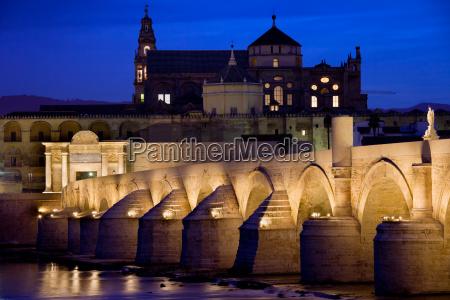 roman bridge and mezquita in cordoba