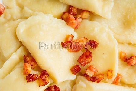 closeup dumplings sprinkled with pork scratchings