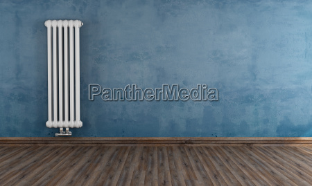 grunge room with vertical radiator