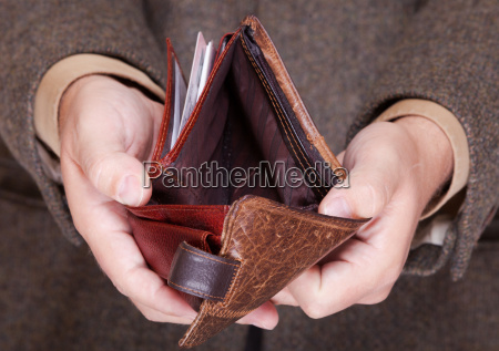 businessman showing empty wallet finance and