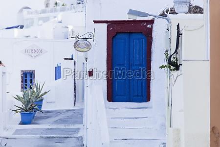 blue wooden door and stairs santorini