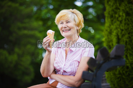grey haired woman relaxing with ice