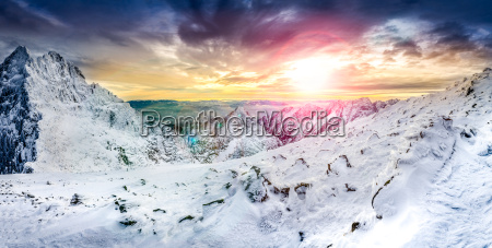 panoramic view of white winter mountains
