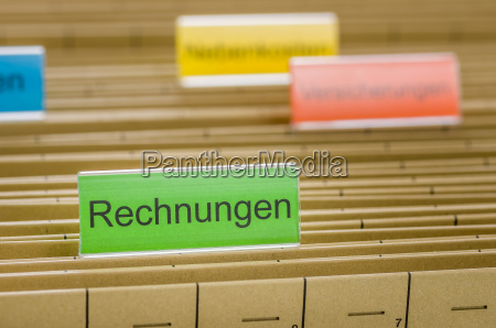 hanging folders labeled bills