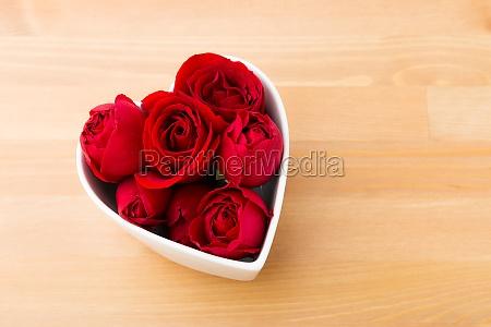red rose inside the heart shape