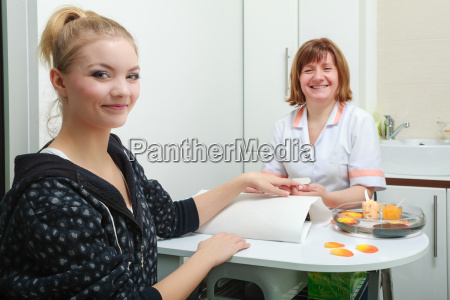 beautician with file filing nails female