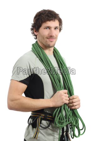 attractive rock climber posing with harness