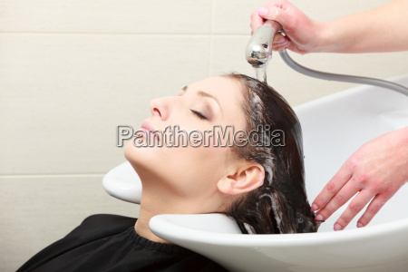 hairstylist washing woman hair hairdressing beauty