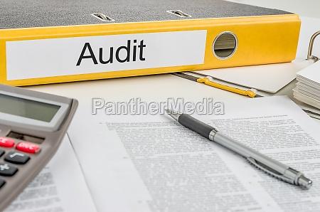 file folders labeled audit
