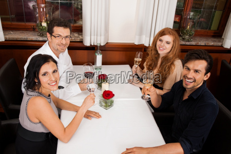 happy laughing group people at restaurant
